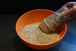 Wet vermiculite is added to the bowl.
