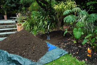 The soil is piled onto the tarpaulin.