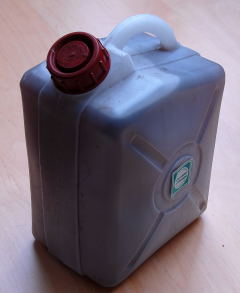 Plastic container filled with sterile water.