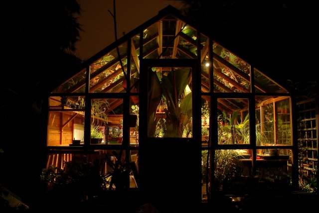 The greenhouse illuminated on a winters night.