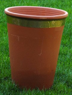 Copper tape fixed around a flower pot