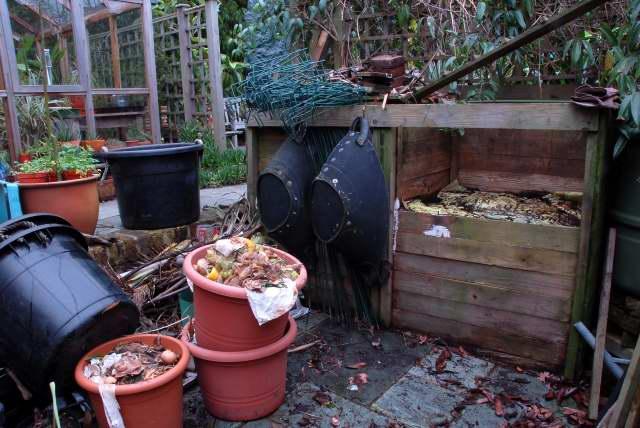 Over filled compost bin.
