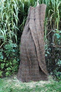 Decorative thatch cover over dormant cold hardy bananas.